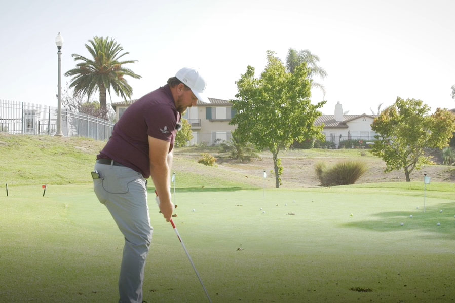 golfer practicing chipping