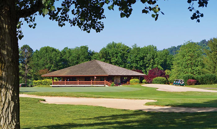 A view of a green with the clubhouse in background at Shawnee State Park Golf Resort